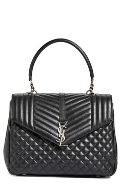 Exquisite stitching and iconic monogram hardware make this classic shoulder bag a staple wardrobe piece.
