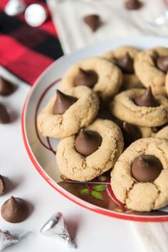 Simple, classic and iconic, peanut butter blossoms are soft & chewy, coated in crackly sugar, and have a Hershey's Kiss in the center of each cookie!