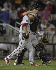 Indiana's Kyle Schwarber congratulates pitcher Joey DeNato for pitching a shut out as the Hoosiers beat Louisville 2-0 in Saturday's second College World Series game in Omaha. DeNato shut out the Cards earlier in the season. (By Matt Stone, The Courier-Journal) June 15, 2013