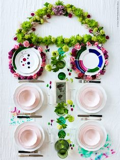 Who says this isn't how to set the table? The picture is from an Ikea catalog, but this is similar to how I like to set the table. Forget one flower filled vase in the center. More fun this way!