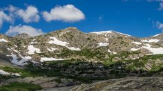This trail follows the McCullough Creek drainage up the gulch beneath the massive summit of 14,225′ Quandary Peak. It starts on an old mining road south of Breckenridge, CO, then changes to si…