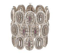 Pulseira de Ouro Nobre 18K com rubis, diamantes brancos e cognac Link:http://www.hstern.com.br/joias/p-produto/P1B203576/pulseira/as-viagens/pulseira-de-ouro-nobre-18k-com-rubis,-diamantes-brancos-e-cognac
