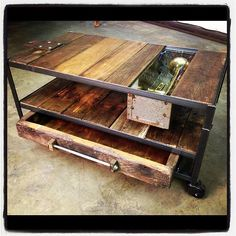 vintage look console table, using reused woods with metal carcass. i like the use of draws and display 'panel'. the hardware fixings would suit my cabinet design