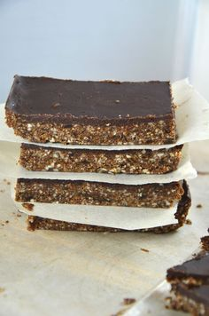 Nut & Seed Nutrition Bar with Chocolate Ganache #veganrecipes #vegandesserts http://www.runningonrealfood.com/nut-and-seed-nutrition-bar-with-chocolate-ganache-raw-vegan/