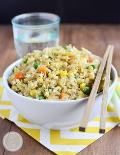 Cauliflower Fried Rice will trick your tastebuds in the best way possible. This 20 minute gluten-free, low-carb recipe will be a hit at your house! | iowagirleats.com