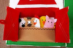 Quiet Book - really cute felt (this page is barnyard finger puppets)