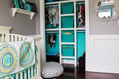 Liking the gray walls and aqua closet - cute way to use a pop of color - and the chevron poufs and pillows!