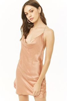 A satin woven mini dress featuring a cowl neckline, high-polish curb chain cami straps that cross at the back, chiffon woven lining, concealed back zipper closure, and a flowy silhouette. Gold Silk Dress, Satin Cami Dress, Contemporary Dresses, Cowl Neck Dress, Cropped Cami, Dress Backs, New Dress, Latest Trends, Clothes