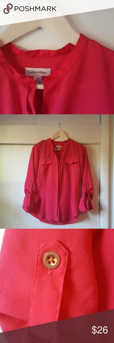 Calvin Klein Bright Pink Blouse Like new!  Calvin Klein 3/4 sleeve length blouse in a bright, hot pink!  Two pockets featured on the front along with gold button accents throughout!   Offers are always welcome! Calvin Klein Tops Blouses