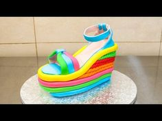 Shows cutting the fondant when you cover it to get rid of the exces. High Heel Wedge Shoe Cake - How To by CakesStepbyStep