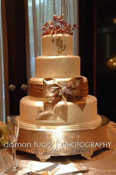 change the gold bow to whatever color theme the wedding is & have a different top piece.