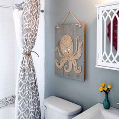 Nautical Ocean Beach Wall Art with Wood Panels from HGTV's Beach Flip:  http://www.completely-coastal.com/2015/10/coastal-beach-wall-art-wood-panels.html