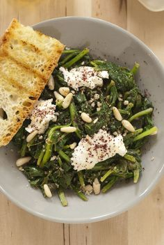 Spinach with sumac, pine nuts, and fresh cheese.  Recipe by Yotam Ottolenghi.