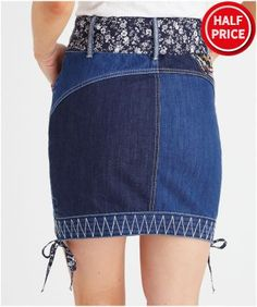 Whether you're hitting the beach or the bar, this embroidered denim skirt will bring out your fun side. We love the mix and match prints and a sassy belt to finish off the look. Approx Length: 50cm Our model is: 5'8""