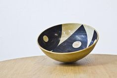 """This large bowl from the 'Torro' series designed by Carl Harry Stålhane and Aune Laukkanen was produced in Sweden by Rörstrand circa 1955. The bowl features an abstract hand painted faiance design on earthenware. The """"Torro"""" series was introduced for the Helsingborgsutsällnigen 'H55' and was only produced for a short period."""
