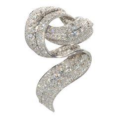 Early David Webb Platinum & Diamond Ribbon Brooch.  Approximately 15 cts.   l Wayne Smith Jewels