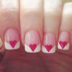 An adorable and heart inspired French manicure you will surely love. Clear polish is used as the nails base color then tipped with thick and v-shaped white polish. Additional pink heart shapes are then drawn over the intersecting white lines.