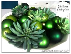 Love the green Christmas ornaments mixed with the succulents! Green bling
