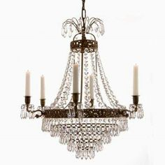 Empire chandelier, 6 arms with candle holders and decorated cast frame. For more details, please contact on the following details: E-mail: info@lusterlightning.com Follow Us on Twitter : @lusterlightning  Skype: lusterlightning What's app: +91-8445883705