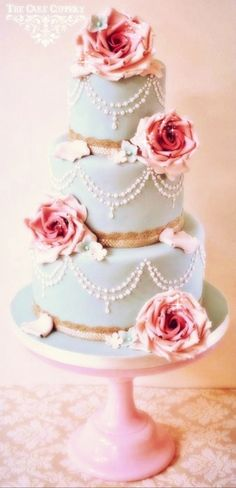 Vintage Wedding cake. Change up the colors and the flowers.