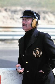 "Colin Chapman. One wonders if the giant ""JPS"" patch adds lightness to that jacket."