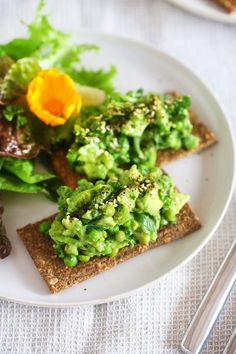 A quick and easy lunch that will take your avocado on toast experience to new levels! The lemon + garlic + pea + herb combo is just divine.