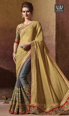 Sonorous Grey and Beige Crepe Silk Designer Saree Famous designers tend to give reign to their imagination and create clothes that look interesting and guided by the desire to attract attention. Be ready to slip in the comfort zone of grey and beige crepe silk and georgette designer saree. It is uniquely crafted with embroidered and patch border work.