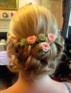 Stunning wedding hair up do with fresh flowers.