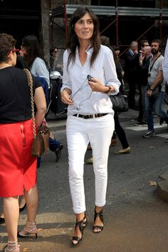 Emmanuelle Alt Street Style Pictures Straight white jeans, black belt, awesome black sandals, white shirt rolled at the sleeves and untucked in the back.