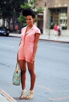 I love the whole look. Solange with a giant bun and a comfy romper