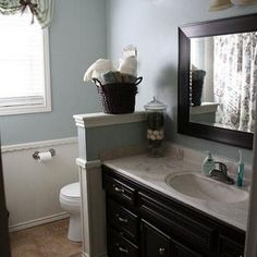 want to do this for the girls bathroom or our master bathroom....love the paint color on the wall!