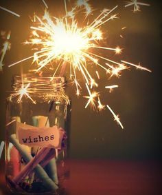 sparkle... I wanna wrap up sparklers and give them out on new years eve! What a fun tradition!