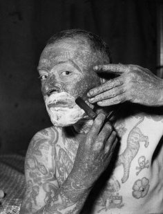"""(c. Bettmann Corbis) 5/9/1937- Tatto van, the tattooed man- Edward Vanderwerer, known better as """"Tattoo Van"""" a member of the World of Mirth Carnival, was pictured as he shaved before his appearance as a carnival attraction, May 8th, at Alexandria, Va."""