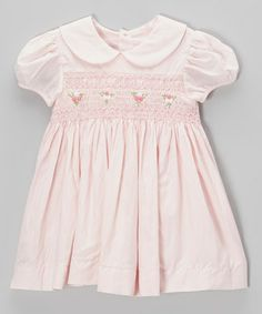 Classic and sweet-as-can-be, this rosette-embroidered frock has little ladies ready for special occasions and adorable outings! A traditional silhouette and Peter Pan collar keeps ladies extra-darling, while breathable cotton and smocking means all day comfort.