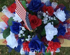 Beautiful patriotic deco mesh floral headstone or mailbox saddle. This saddle uses deco mesh which is better suited for outdoor use than many other products available. Red, white, and blue mesh make this a perfect piece for Memorial Day, Fourth of July, and everyday American pride! The