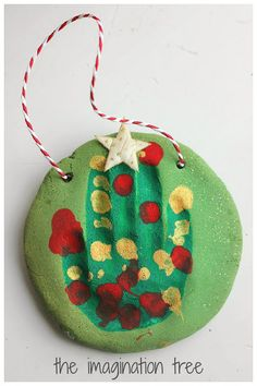 Salt Dough Handprint Christmas Tree Ornaments - The Imagination Tree - How to make some adorable Christmas tree ornaments from green sparkly salt dough, using little handprints! What a lovely keepsake or gift for Granny! Handprint Christmas Tree, Preschool Christmas, Christmas Crafts For Kids, Christmas Activities, Family Christmas, Christmas Projects, Christmas Traditions, Christmas Tree Ornaments, Holiday Crafts