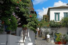 An old man walks on traditional cobbled road of Hora Skopelos