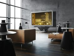 Cool room - concrete steel wood and throw in some B&O audio visual equipment = whats not to love