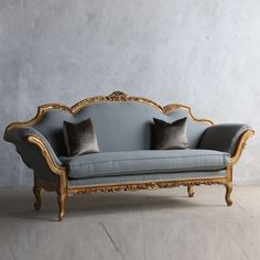 Highly+unique+italianate+gilt+daybed+with+streaks+of+natural+wood.+Beautiful+sloped,+romantic+arching+arms+and+light,+slate+blue+upholstery.+44H+x+89W+x+31DSeat+Height:+21Arm+Height:+30Circa:+1920  Return+Policy: This+item+is+not+eligible+for+returns+or+exchanges+so+please+make+sure+to+look+over+the+pictures+and+ask+questions+before+purchasing+this+beautiful+piece.