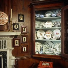 Corner cupboard with a mixture of East Asian and English ceramics, at Hill Top, Cumbria. ©National Trust Images/Geoffrey Frosh