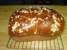 Honey Oat Bread (Bread Machine)... Mine definitely did not look like this.  But it definitely did taste great.  I added probably a tablespoon of wheat gluten with our Ultragrain flour.  I also added another probably 1/8th of a cup of water because I added the gluten.