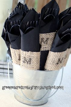 Green Acres Hobby Farm held a rustic wedding complete with monogrammed burlap strips. The plasticware and paper napkins were wrapped with stamped fabric napkin ring ribbons that could be discarded after use. #napkinrings #burlap #diy