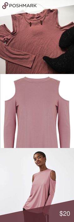 Topshop Rose Cold Shoulder Tee Relaxed rose coloured top with cold shoulder cut outs.  49% Modal, 45% Cotton, 6% Elastane. New with tags. Please carefully review each photo before purchase as they are the best descriptors of the item. My price is firm. No trades. First come, first served. Thank you! :) Topshop Tops Tees - Long Sleeve