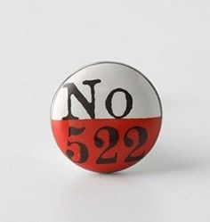 Vintage-style ceramic and brass Lucky Number knob in red and yellow, from Anthropologie, with ghost sign typographic design. Dresser Knobs, Cabinet Knobs, Door Knobs, Cupboard Handles, Cabinet Hardware, Diy Cabinets, Custom Cabinets, Knobs And Pulls, Drawer Pulls