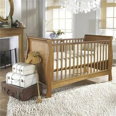 Izziwotnot Bailey Sleigh Cot Bed in Oak -  a stunning sleigh cot bed, with chic styling and timeless elegance. perfect investment piece the cot bed grows with your little one as it converts effortlessly from a cot to toddler bed.