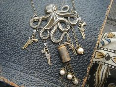 Steampunk Octopus with guns and Bullets Necklace on etsy