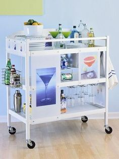 Isn't the booze how many end up needing a changing table... Changing table made into a portable bar!