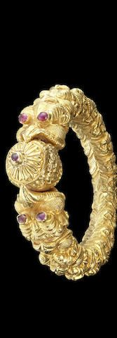 A ruby-set repousse gold Bangle Madras