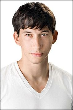 Wholesome photo of Adam Driver, clean shaven with bangs looking young; from Static.playbill.com