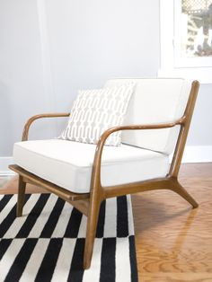 new life for a mid-century modern chair. Sleek and welcoming
